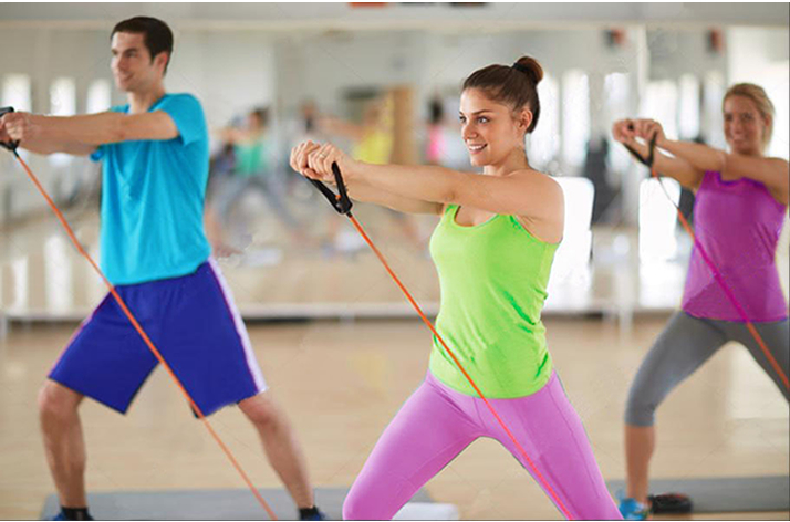 Man and 2 women using resistance band to exercise