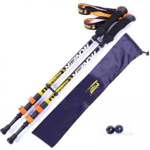 Pair of yellow hiking poles with carry bag